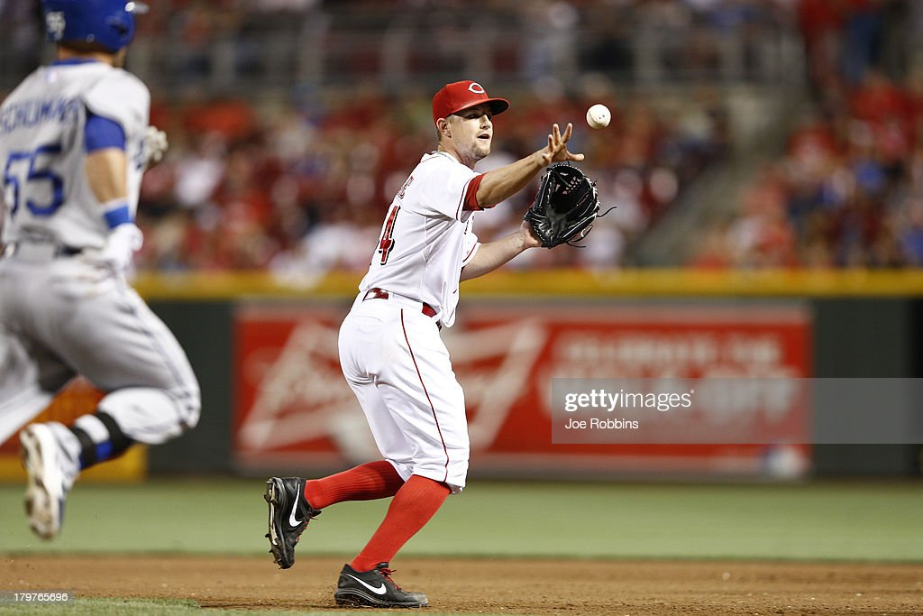 <a gi-track='captionPersonalityLinkClicked' href=/galleries/search?phrase=Mike+Leake&family=editorial&specificpeople=5330779 ng-click='$event.stopPropagation()'>Mike Leake</a> #44 of the Cincinnati Reds makes a play after fielding the ball in front of the mound against the Los Angeles Dodgers at Great American Ball Park on September 6, 2013 in Cincinnati, Ohio. The Reds won 3-2.