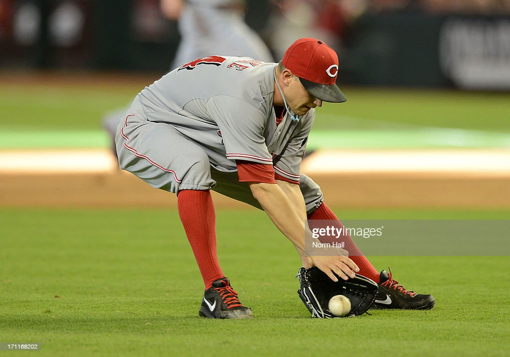 <a gi-track='captionPersonalityLinkClicked' href=/galleries/search?phrase=Mike+Leake&family=editorial&specificpeople=5330779 ng-click='$event.stopPropagation()'>Mike Leake</a> #44 of the Cincinnati Reds makes a play on a ground ball against the Arizona Diamondbacks at Chase Field on June 22, 2013 in Phoenix, Arizona.