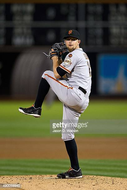 Mike Leake of the San Francisco Giants pitches against the Oakland Athletics during the first inning at Oco Coliseum on September 25 2015 in Oakland...