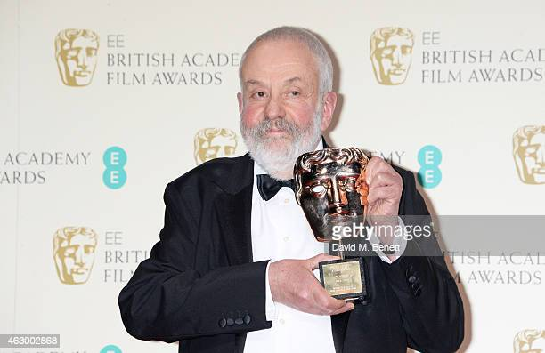 Mike Leigh winner of the BAFTA Fellowship poses in the winners room at the EE British Academy Film Awards at The Royal Opera House on February 8 2015...