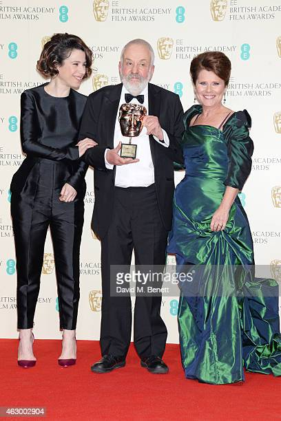 Mike Leigh winner of the BAFTA Fellowship poses with presenters Sally Hawkins and Imelda Staunton in the winners room at the EE British Academy Film...