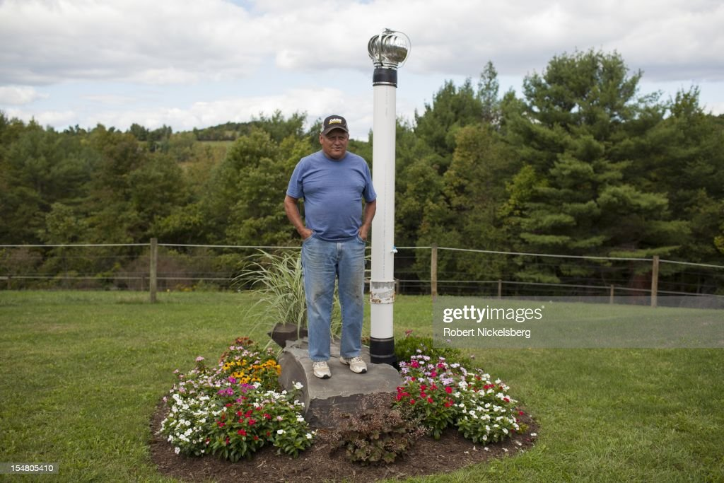 Mike Leighton, 68 years, stands next to a venting pipe for a contaminated water well September 10, 2012 at his home in Granville Summit, Pennsylvania. Leighton's water well was contaminated by methane gas released from a hydrofracked gas well drilled by the Chesapeake Energy in May 2012. Chesapeake has supplied Creighton's home with a water filtration system and delivers drinking water. Methane gas from the fracked well is also leaking into his basement for which Chesapeake provides a vacuum pump. Leighton and his wife built their retirement home on 10-acres of land which sits above the Marcellus Shale gas field. Hydrofracking is a controversial drilling method which pumps millions of gallons of water, sand and chemicals into horizontally drilled wells to stimulate the release of the gas. The Marcellus Shale gas field stretches diagonally across West Virginia, Ohio, Pennsylvania and New York State. Hydrofracking's environmental impact is a politically sensitive issue in a resource dependent state.