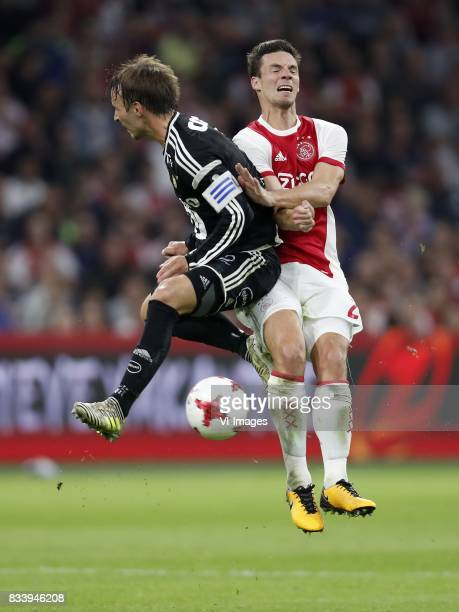 Mike Lindemann Jensen of Rosenborg BK Nick Viergever of Ajax during the UEFA Europa League fourth round qualifying first leg match between Ajax...