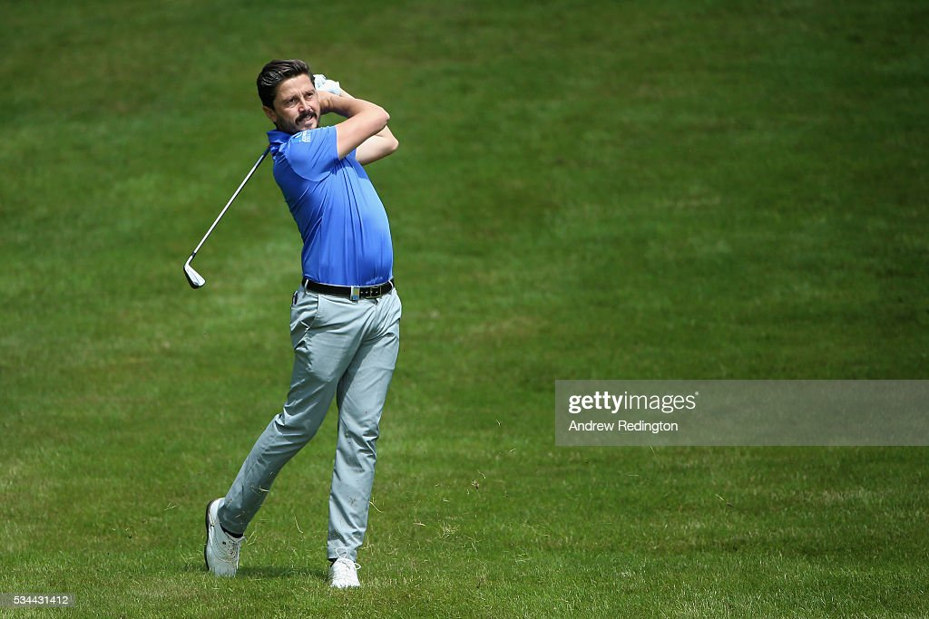 Mike Lorenzo-Vera of France hits his 2nd shot on the 4th hole during day one of the BMW PGA Championship at Wentworth on May 26, 2016 in Virginia Water, England.