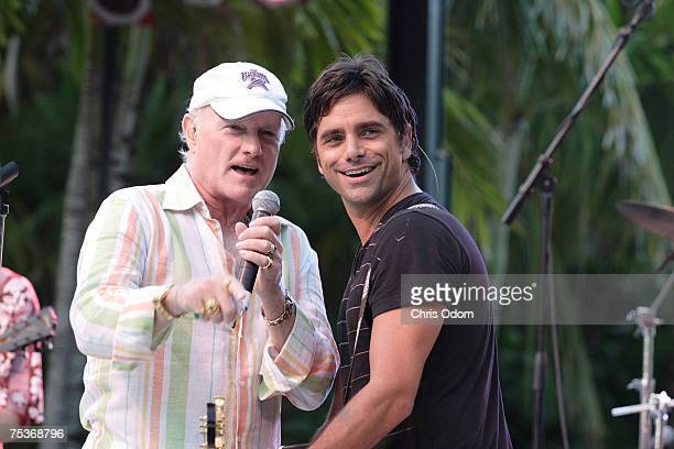 Mike Love and John Stamos perform with The Beach Boys at the Jacquelyn Love Bella Mar Swim fashion show at the Raleigh Hotel on South Beach on July...