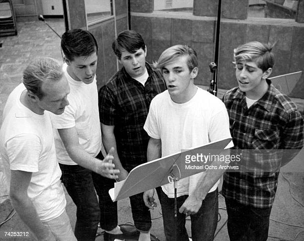 Mike Love Brian Wilson Carl Wilson Dennis Wilson and David Marks of the rock and roll band 'The Beach Boys' sing at a music stand in circa 1963