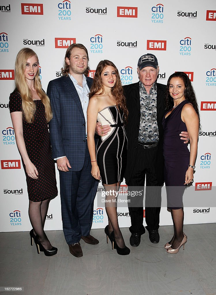 Mike Love of the Beach Boys (2R), wife Jacqueline Piesen (R) and family arrive at the EMI Music Sound Foundation fundraiser at Somerset House on September 24, 2012 in London, England.