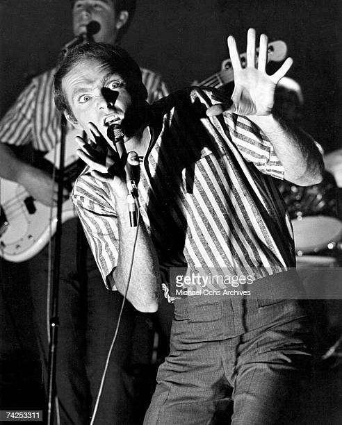 Mike Love of the rock and roll band 'The Beach Boys' performs with Brian Wilson in the background on the TV show 'Shindig' in December 1964 in Los...