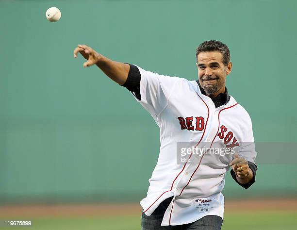Mike Lowell former Red Sox third baseman throws out a ceremonial first pitch before the game against the Seattle Mariners on July 23 2011 at Fenway...