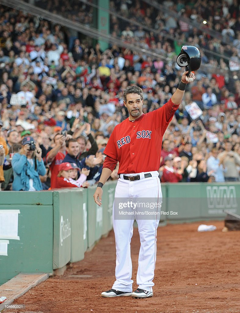Mike Lowell of the Boston Red Sox acknowledges an ovation after being pulled from a game against the New York Yankees on October 2 2010 at Fenway...