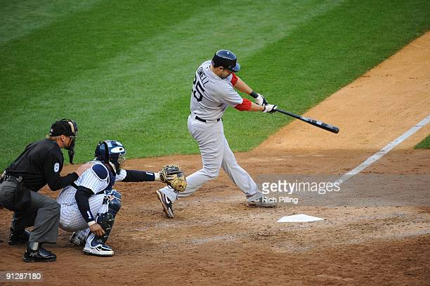 Mike Lowell of the Boston Red Sox bats during the game against the New York Yankees at Yankee Stadium in the Bronx New York on September 26 2009 The...