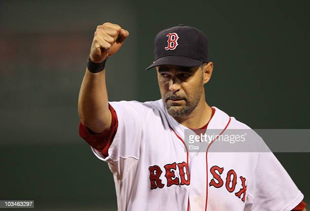 Mike Lowell of the Boston Red Sox celebrates as teammate JD Drew makes the catch for the final out of the third inning against the Los Angeles Angels...