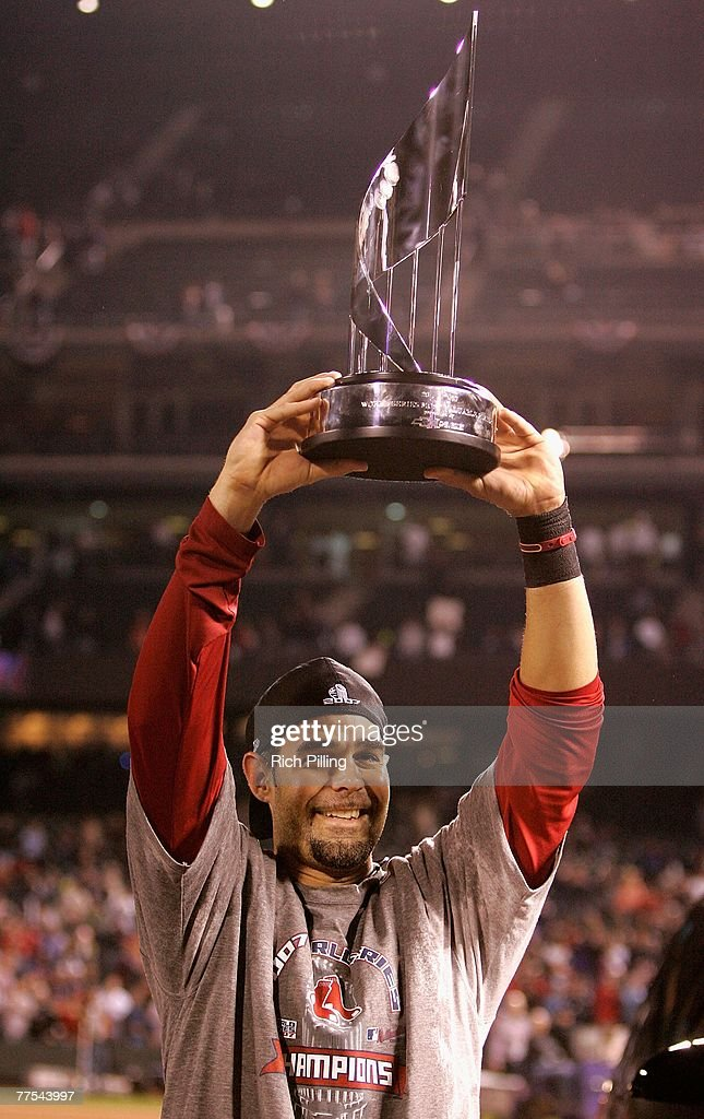 Mike Lowell of the Boston Red Sox celebrates with the World Series MVP trophy after defeating the Colorado Rockies in Game Four of the 2007 World...