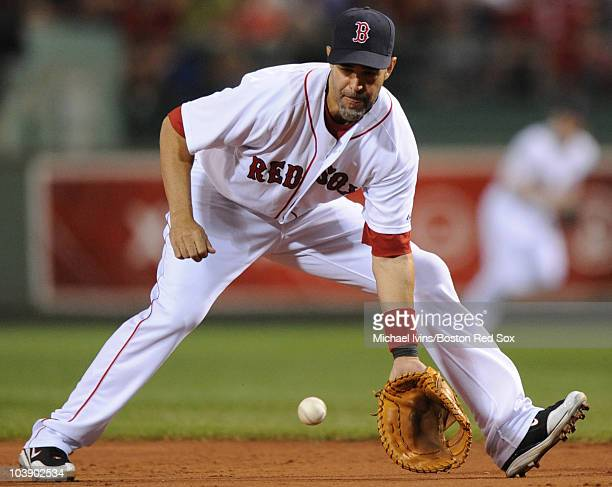 Mike Lowell of the Boston Red Sox fields a ground ball off the bat of Dan Johnson of the Tampa Bay Rays in the first inning on September 7 2010 at...