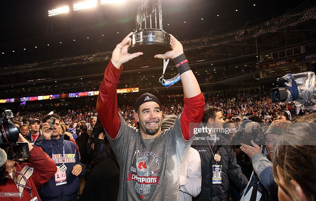 Mike Lowell of the Boston Red Sox holds the MVP trophy after the Red Sox won Game Four by a score of the 43 to win the 2007 Major League Baseball...