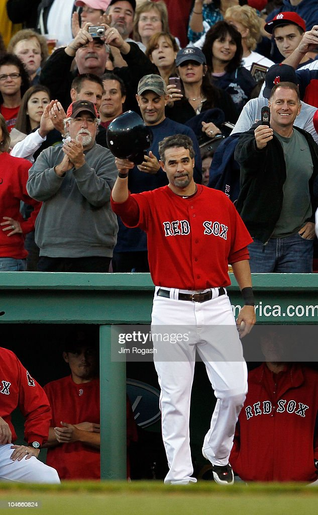 Mike Lowell of the Boston Red Sox reacts to the applause after he was replaced by a pinch runner in the fifth inning during the first game of a...