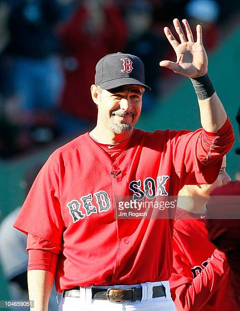 Mike Lowell of the Boston Red Sox reacts to the applause of fans during a ceremony in his honor before the first game of a doubleheader against the...