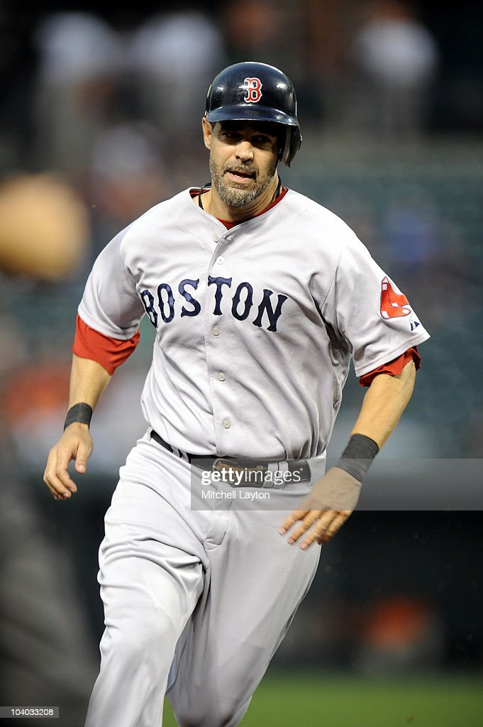 Mike Lowell of the Boston Red Sox runs to third base during a baseball game against the Baltimore Orioles on September 2 2010 at Camden Yards in...
