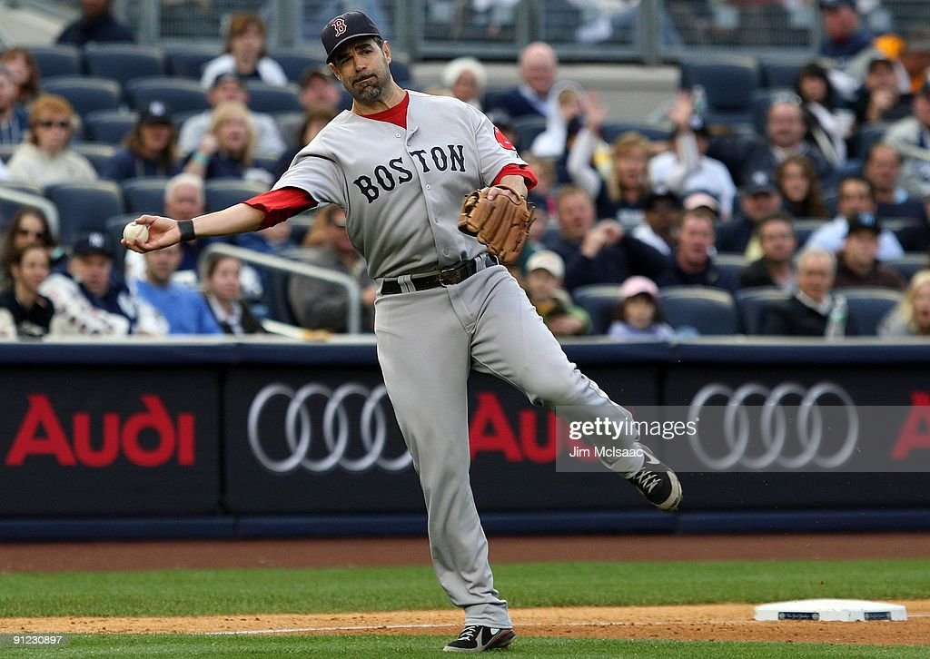 Mike Lowell of the Boston Red Sox throws against the New York Yankees on September 26 2009 at Yankee Stadium in the Bronx borough of New York City