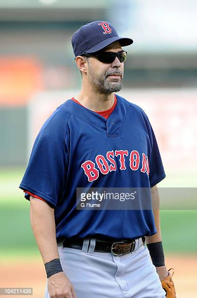 Mike Lowell of the Boston Red Sox warms up before the game against the Baltimore Orioles at Camden Yards on September 2 2010 in Baltimore Maryland...