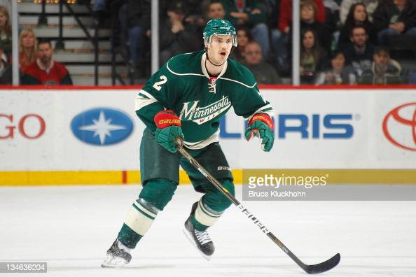 Mike Lundin of the Minnesota Wild defends against the Tampa Bay Lightning during the game at the Xcel Energy Center on November 28 2011 in St Paul...