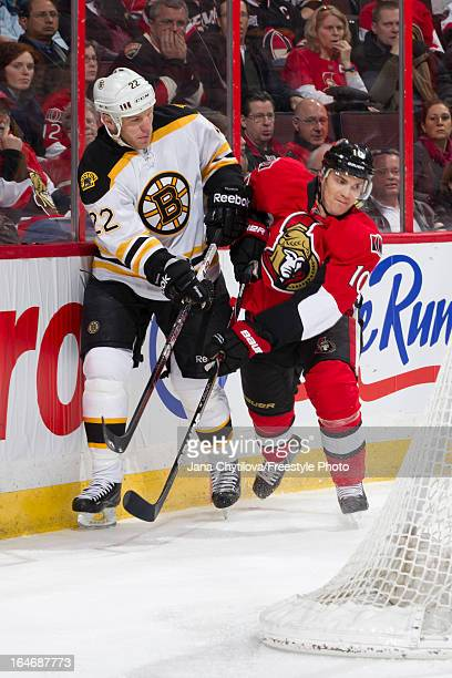 Mike Lundin of the Ottawa Senators battles for position against Shawn Thornton of the Boston Bruins during an NHL game at Scotiabank Place on March...