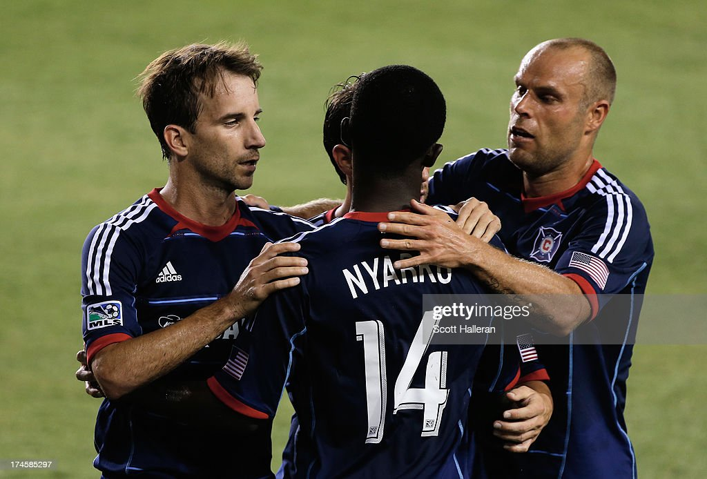 Mike Magee #9 (L) and <a gi-track='captionPersonalityLinkClicked' href=/galleries/search?phrase=Patrick+Nyarko&family=editorial&specificpeople=4824163 ng-click='$event.stopPropagation()'>Patrick Nyarko</a> #14 (C) and Joel Larentowicz #26 (R) of the Chicago Fire celebrate after Magee scored a second half goal against the Houston Dynamo at BBVA Compass Stadium on July 27, 2013 in Houston, Texas.