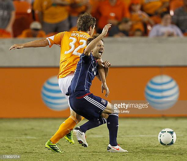 Mike Magee of Chicago Fire and Bobby Boswell of Houston Dynamo get tangled up at BBVA Compass Stadium on July 27 2013 in Houston Texas