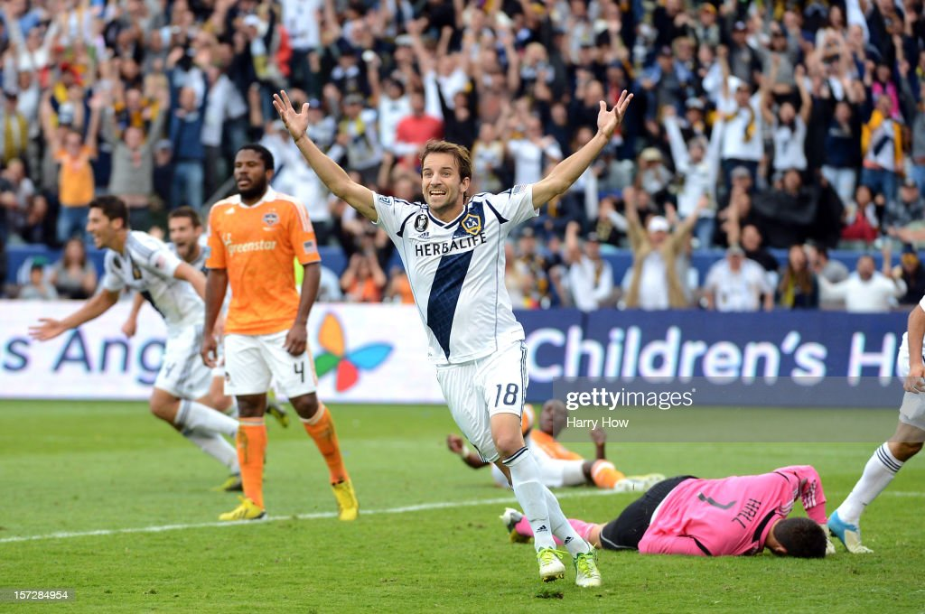 Mike Magee of Los Angeles Galaxy celebrate the goal of Omar Gonzalez in the second half against the Houston Dynamo in the 2012 MLS Cup at The Home...