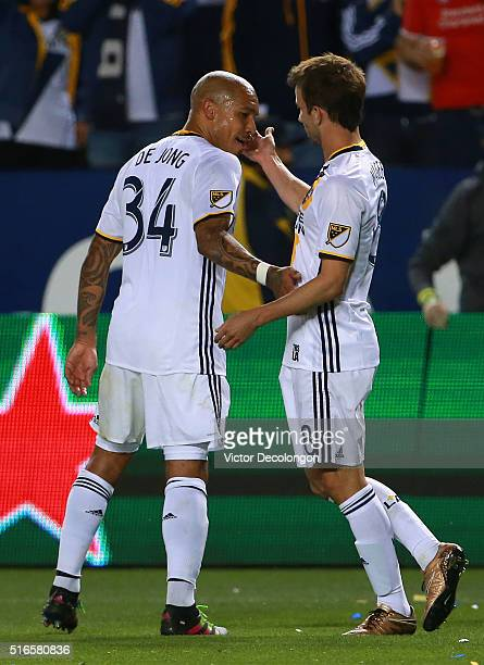 Mike Magee of Los Angeles Galaxy celebrates his goal against DC United wth teammate Nigel de Jong during the second half of their MLS match at...