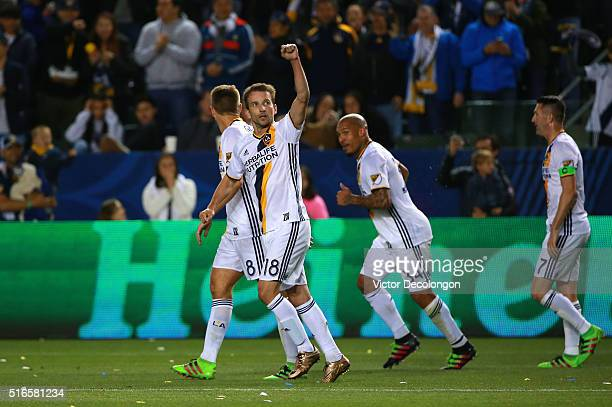 Mike Magee of Los Angeles Galaxy pumps his fist toward the stands after his goal against DC United during the second half of their MLS match at...
