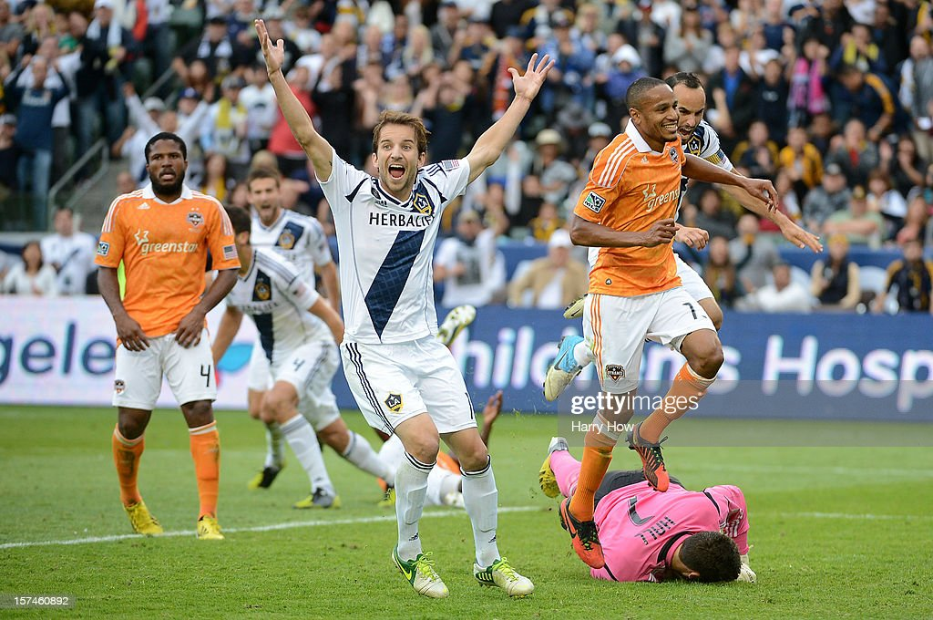 Mike Magee of Los Angeles Galaxy reacts after teammate Omar Gonzalez scores a goal in the second half past goalie Tally Hall of Houston Dynamo in the...
