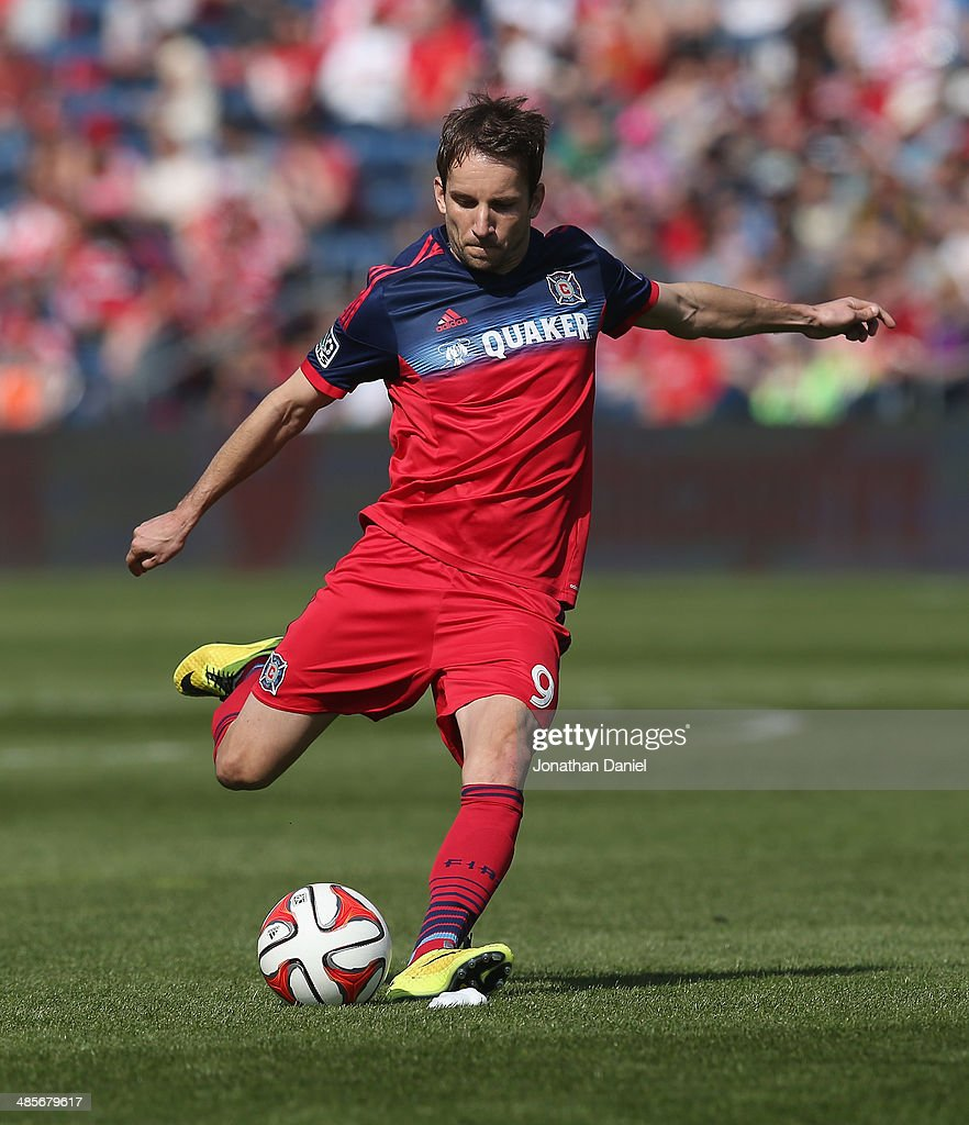 Mike Magee of the Chicago Fire shoots a penalty kick against the New England Revolution during an MLS match at Toyota Park on April19 2014 in...