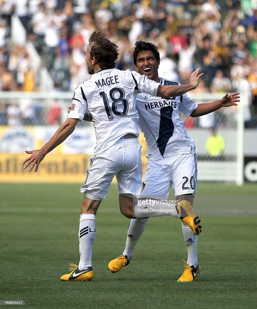 Mike Magee of the Los Angeles Galaxy celebrates his goal in the first half with teammate AJ DeLaGarza against the Chicago Fire during the MLS match...