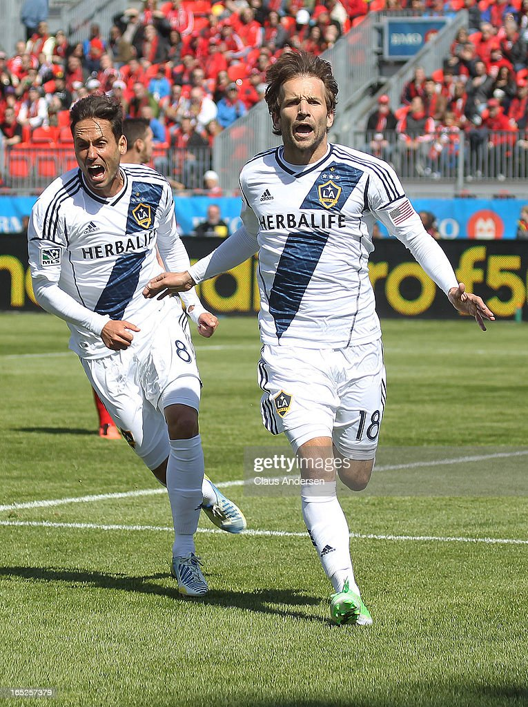 Mike Magee #18 of the Los Angeles Galaxy celebrates his goal with teammate Marcelo Sarvas #8 in an MLS game against the Toronto FC on March 30, 2013 at BMO field in Toronto, Ontario, Canada. The LA Galaxy and the Toronto FC played to a 2-2 tie.