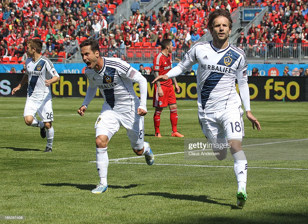 Mike Magee of the Los Angeles Galaxy celebrates his goal with teammate Marcelo Sarvas in an MLS game against the Toronto FC on March 30 2013 at BMO...