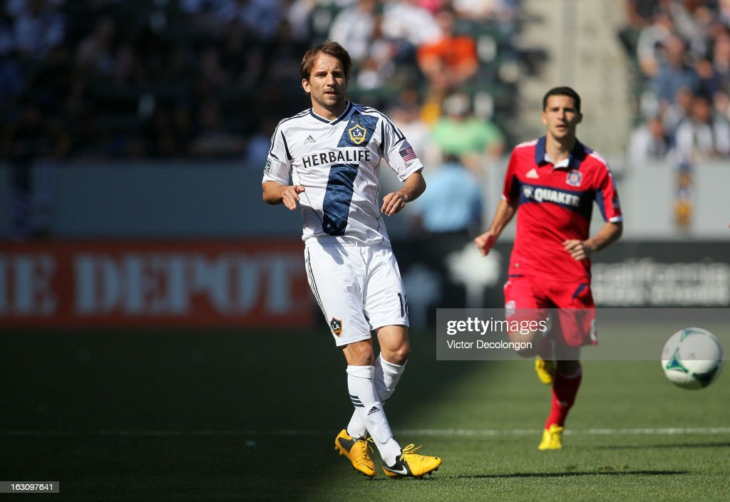 Mike Magee of the Los Angeles Galaxy chips a pass forward during the MLS match against the Chicago Fire at The Home Depot Center on March 3 2013 in...