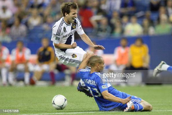 Mike Magee of the Los Angeles Galaxy collides with Matteo Ferrari of the Montreal Impact during the MLS match at the Olympic Stadium on May 12 2012...