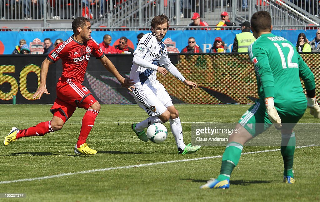 Mike Magee of the Los Angeles Galaxy gets set to score a goal against Joseph Bendik of Toronto FC in an MLS game on March 30 2013 at BMO field in...