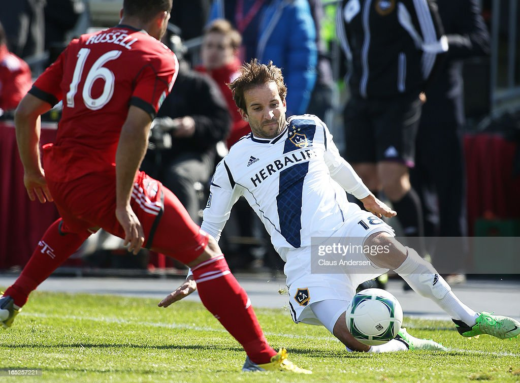 Mike Magee #18 of the Los Angeles Galaxy goes down to play a ball in an MLS game against the Toronto FC on March 30, 2013 at BMO field in Toronto, Ontario, Canada. The LA Galaxy and the Toronto FC played to a 2-2 tie.