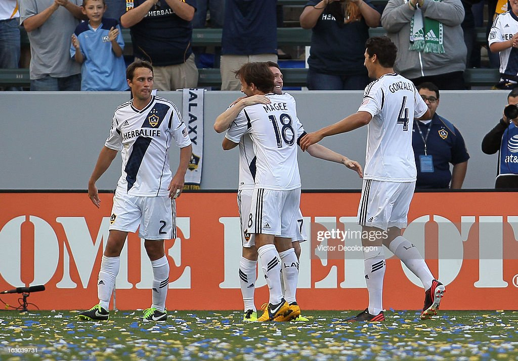 Mike Magee of the Los Angeles Galaxy hugs teammate Robbie Keane after Keane's goal in the second half against the Chicago Fire during the MLS match...