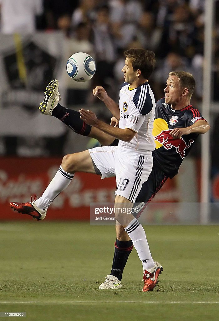 Mike Magee #18 of the Los Angeles Galaxy is challenged by Jan Gunnar Solli #8 of the New York Red Bulls for the ball in the first half at The Home Depot Center on May 7, 2011 in Carson, California. The Red Bulls and Galaxy played to a 1-1 draw.