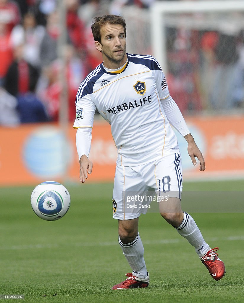 Mike Magee of the Los Angeles Galaxy moves the ball up the field against the Chicago Fire in an MLS match on April 17 2011 at Toyota Park in...