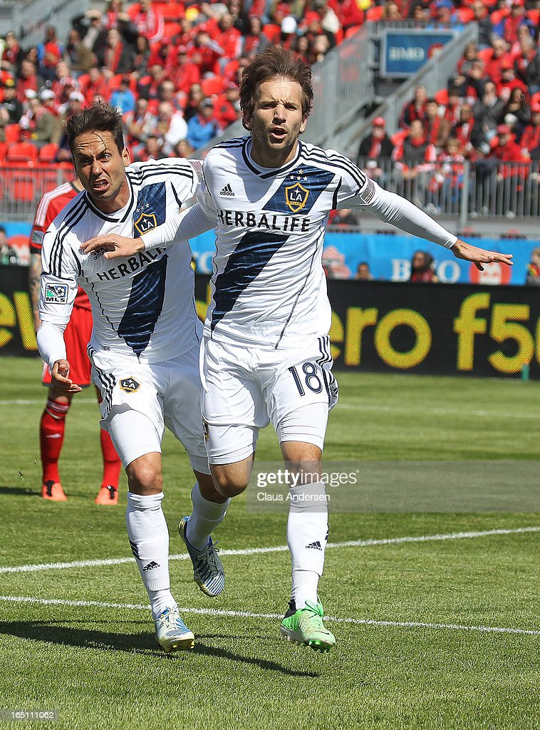 Mike Magee #18 of the Los Angeles Galaxy shows his excitement after scoring with teammate Marcelo Sarvas #8 in an MLS game against the Toronto FC on March 30, 2013 at BMO Field in Toronto, Ontario, Canada.