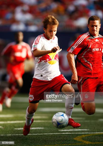 Mike Magee of the New York Red Bulls plays the ball against the Toronto FC at Giants Stadium in the Meadowlands on August 17 2008 in East Rutherford...