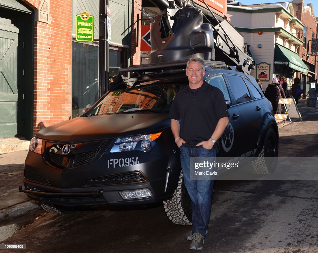 Mike Majeski of 'Pursuit Systems' poses with a picture car at the Acura Master Class 'Cue Car Chase' on January 18, 2013 in Park City, Utah.