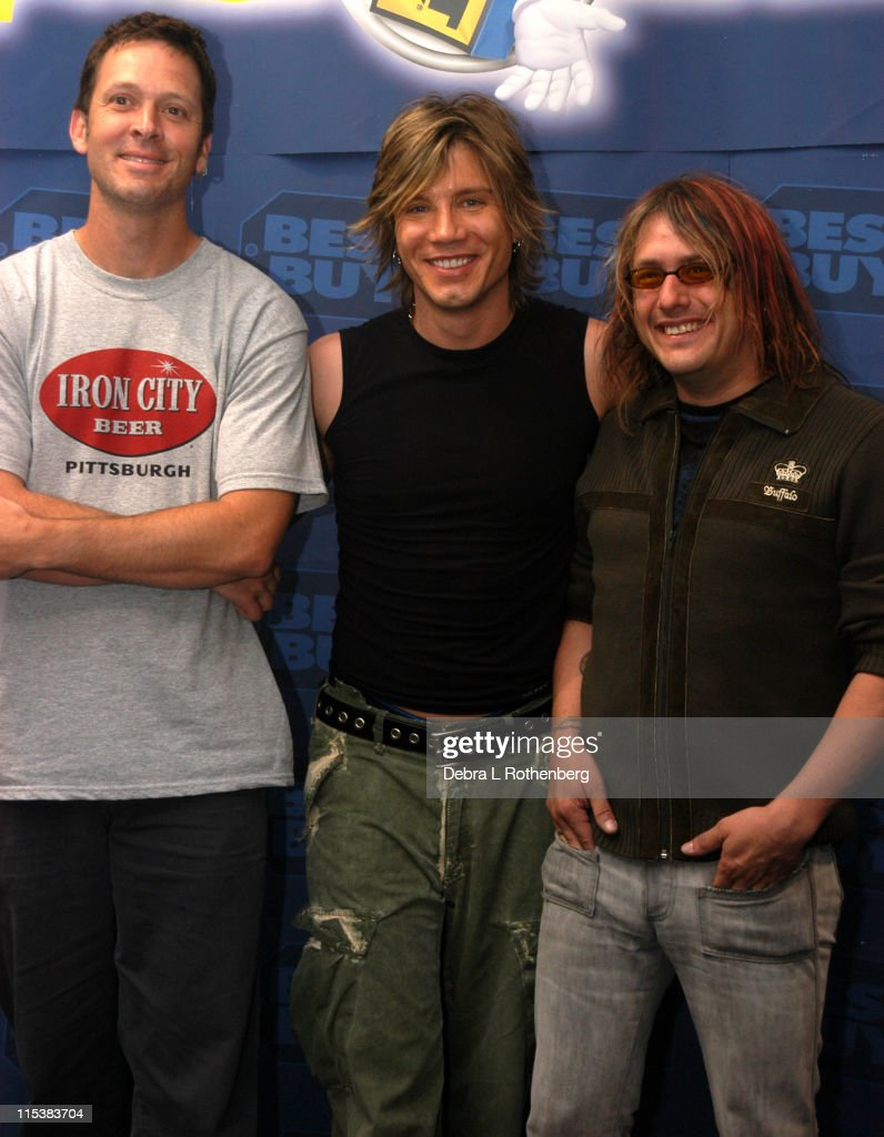 Mike Malinin Johnny Rzeznik and Robbie Takac during Goo Goo Dolls Hold InStore Autograph Signing for Fans at Best Buy 86th Street and Lexington...