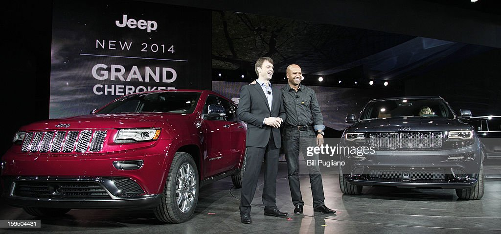 Mike Manley (left), President and CEO Jeep Brand, and Ralph Gilles (right), President and CEO Jeep SRT Brand and Motor Sports, Chrysler Group LLC, stand with the new 2014 Jeep Grand Cherokee (left) and 2014 Jeep Grand Cherokee SRT (right) after their world debut at the media preview of the 2013 North American International Auto Show at the Cobo Center January 14, 2013 in Detroit, Michigan. Approximately 6,000 members of the media from 68 countries are attending the show this year. The 2013 NAIAS opens to the public January 19th.