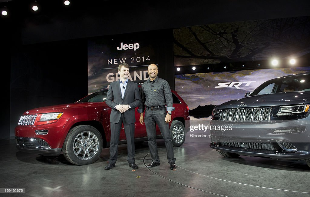 Mike Manley, president of Chrysler Group LLC's Jeep brand and head of international operations for Chrysler Group, left, and Ralph Gilles, president and chief executive officer of SRT Brand and Motorsports for Chrysler Group LLC, smile on stage during the 2013 North American International Auto Show (NAIAS) in Detroit, Michigan, U.S., on Monday, Jan. 14, 2013. The Detroit auto show runs through Jan. 27 and will display over 500 vehicles, representing the most innovative designs in the world. Photographer: Daniel Acker/Bloomberg via Getty Images