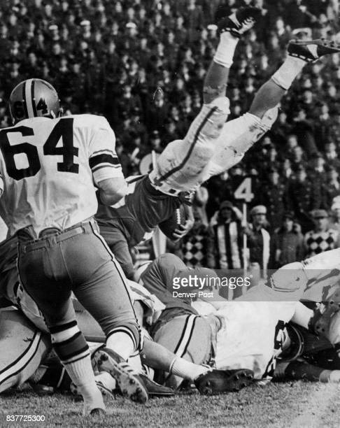Mike Mark dives for a first down on a thirdandtwo try Force punt Among the Colorado defenders is end Lenny from the Falcon 48 but comes up short...